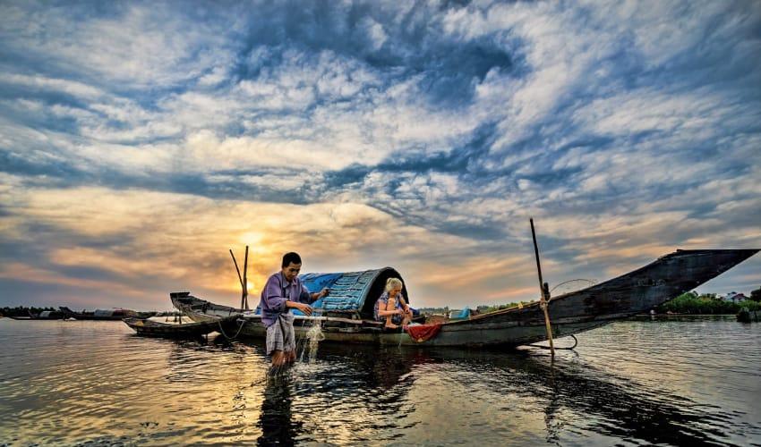 people fishing each day in cau hai lagoon